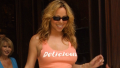 Mariah Carey wearing a tank top that says delicious