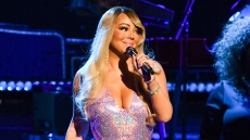 Mariah Carey performs onstage with Moroccan and Monroe