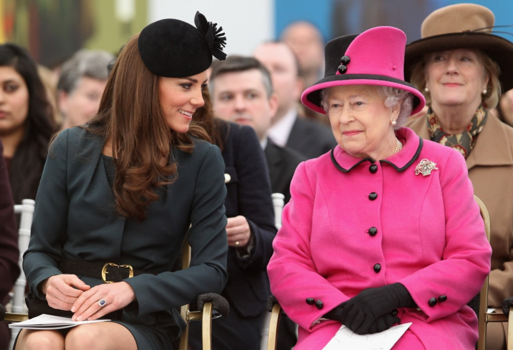 Queen Elizabeth II (R) and Catherine, Duchess of Cambridge (L) watch a fashion show at De Montfort University on March 8, 2012 in Leicester, England.