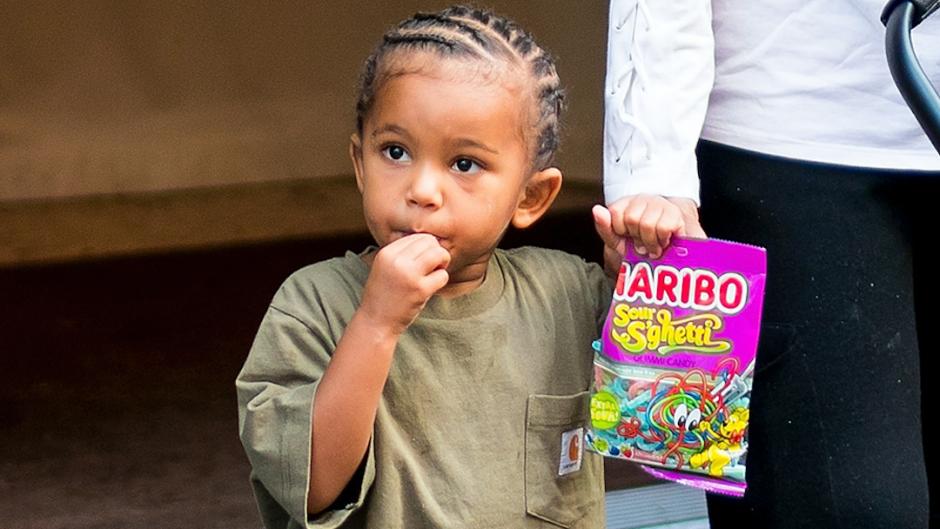 Kim Kardashian's son Saint West eating candy while walking in NYC.