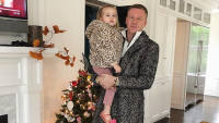 macklemore with his daughter wearing leopard