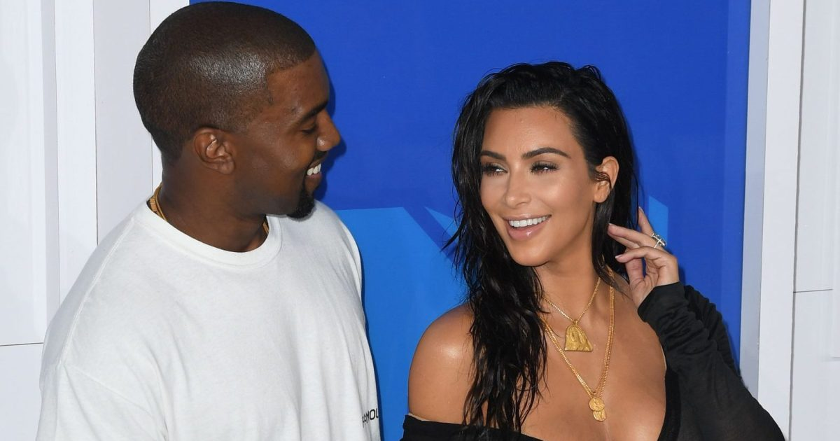 7a806e330 Kim Kardashian and Kanye West Set Up Yeezy Stand With the Kids