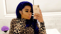 Blac Chyna selfie on Instagram with blue hair and cheetah print jumpsuit
