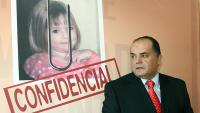 """Former Policia Judiciaria (Crime Police) detective Goncalo Amaral poses near a poster with his book entitled """"Maddie:The Truth about the Lie"""" about the disappearance of British girl Madeleine McCann during its presentation in Lisbon July 24, 2008. Amaral led the investigation on the McCann case unthil he got removed from the case."""