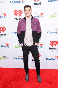 Bachelorette Blake Horstmann in purple jacket and black pants