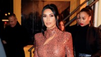 Kim Kardashian snakeskin outfit hair up instagram