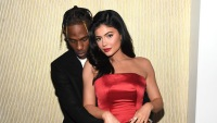 Travis Scott grammys Kylie Jenner red satin strapless dress PDA hugging