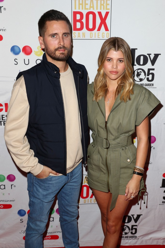 Scott Disick jeans and jacket Sofia Richie green romper blonde hair