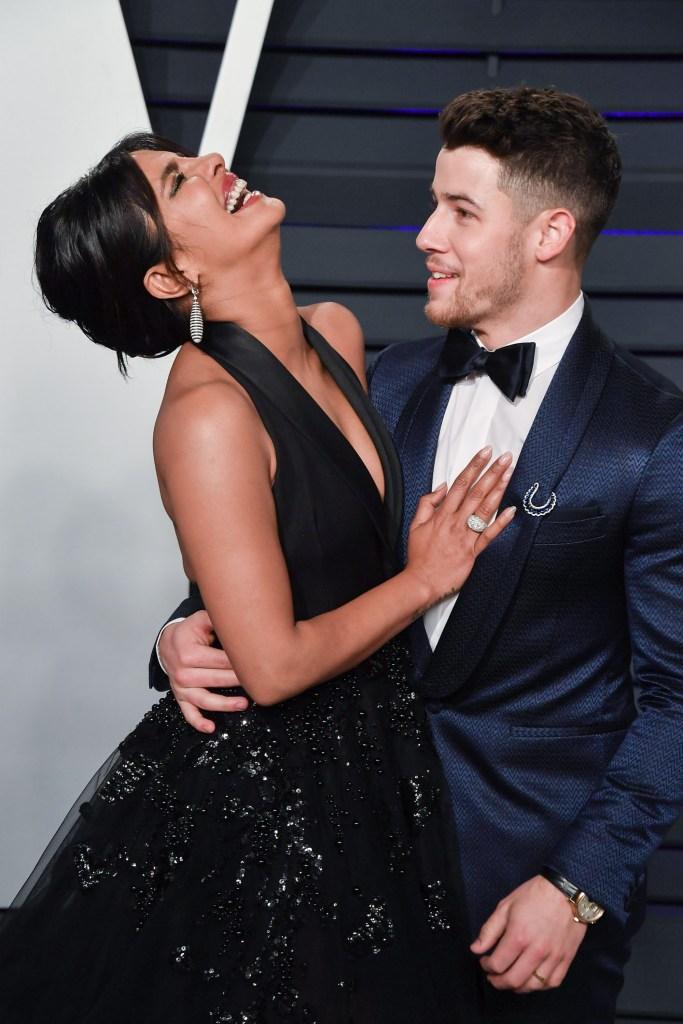 Nick Jonas blue suit Priyanka Chopra black ball gown vanity fair party
