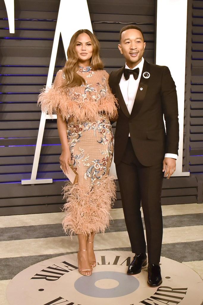 Chrissy Teigen John Legend oscars vanity fair party feather dress