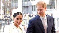 Meghan Markle white hat white coat Prince Harry suit holding hands