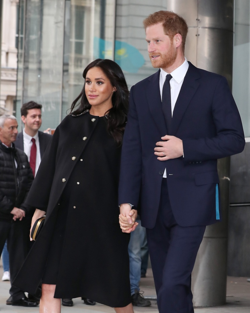 Prince Harry blue suit and Meghan Markle black dress baby bump Duke And Duchess Of Sussex