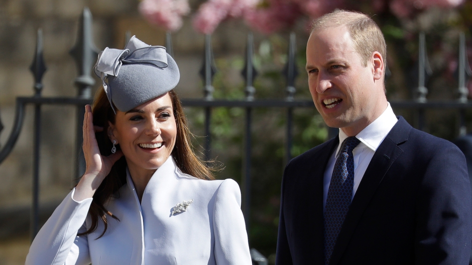Kate Middleton wearing a blue outfit with Prince William