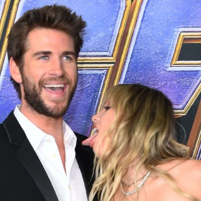 Miley Cyrus licks Liam Hemsworth red carpet avengers black dress