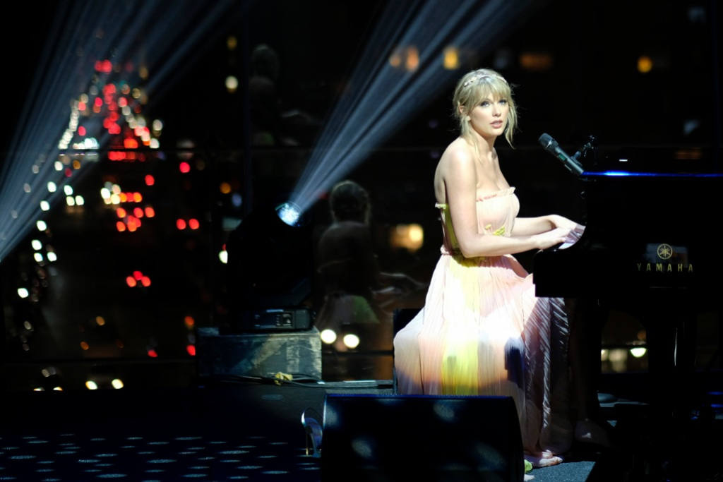 Taylor Swift Time 100 gala playing piano singing yellow and pink dress