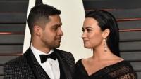 Wilmer Valderrama and Demi Lovato 2016 oscars black dress black tux red carpet