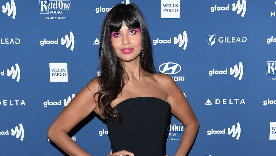 Jameela Jamil in a black dress.