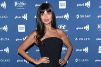 Jameela Jamil in a black dress.