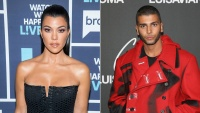 Kourtney Kardashian black strapless dress Younes Bendjima red coat