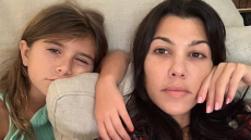 Kourtney Kardashian and Penelope Disick ose together in bed for a selfie