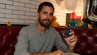 Scott Disick Eating a Burger Wearing a Gray Sweatshirt