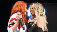 Bella Thorne and Tana Mongeau performing on stage.