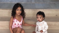 north and chicago west sitting side by side
