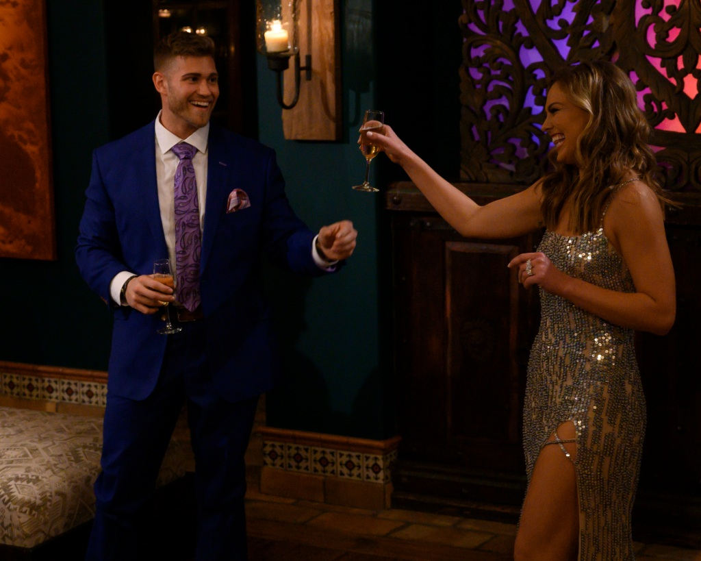 Luke P. Holding a Glass with Hannah Brown