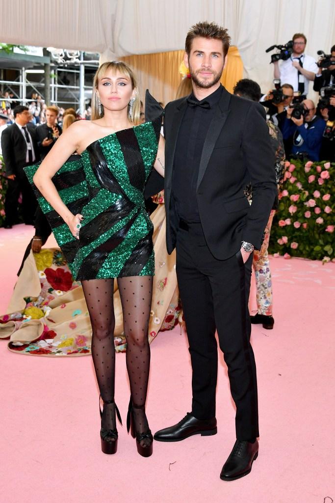 Miley Cyrus Liam Hemsworth 2019 met gala red carpet green and black dress black suit
