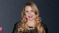 Teen mom Kailyn Lowry blonde hair curled red lipstick black top