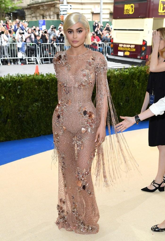Kylie Jenner 2017 met gala versace nude gown see through red carpet