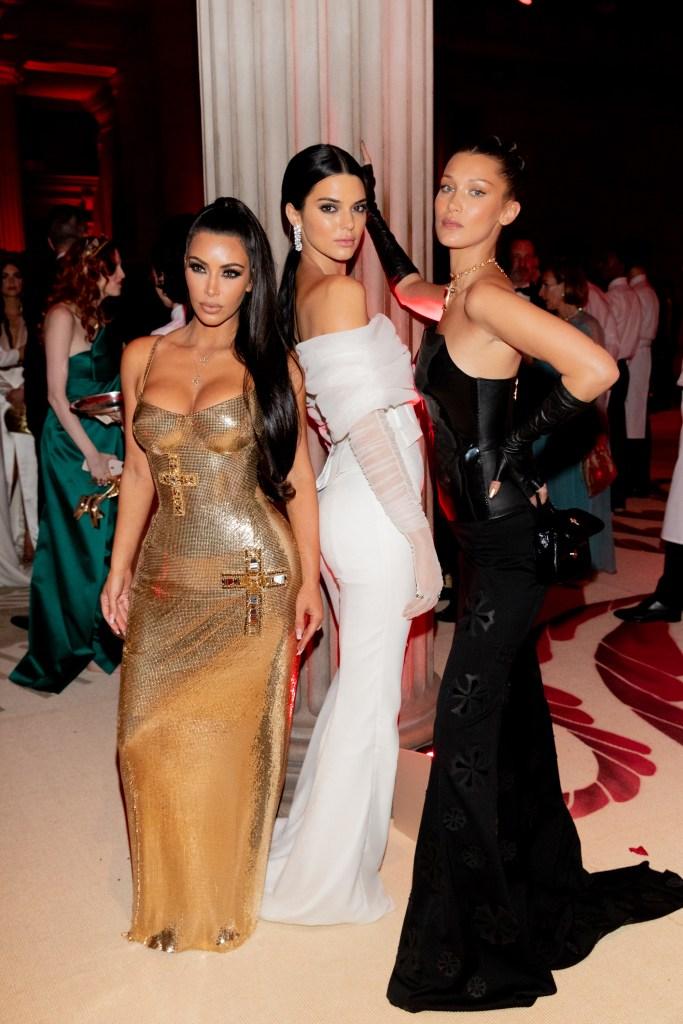 Kim Kardashian Kendall Jenner Bella Hadid 2018 met gala heavenly bodies gold versace dress white pantsuit black dress