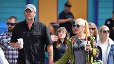 Blake Shelton Wearing a Black Shirt Holding Hands with Gwen Stefani in Blue Sunglasses