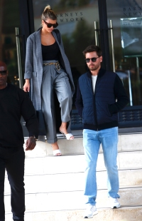 Scott Disick blue padded bomber jacket grey tshirt light blue jeans sungalsses