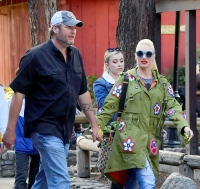 Blake Shelton Wearing a Black Shirt Holding Hands with Gwen Stefani in Blue Sunglasses