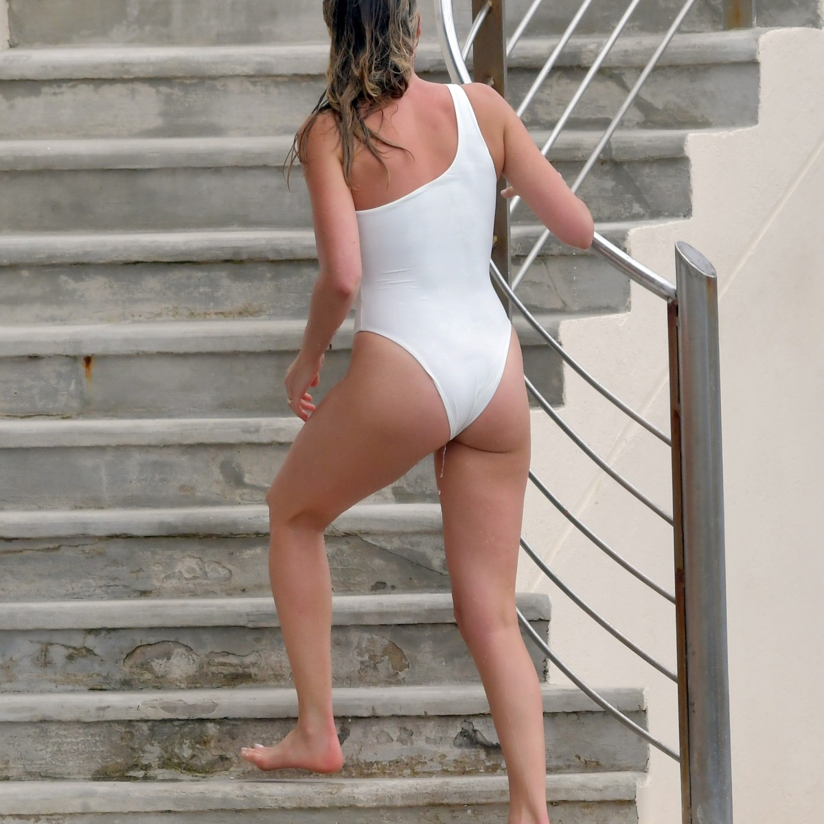 Margot Robbie Brings All the Heat to Cannes in a Revealing, White Swimsuit — See Pics!