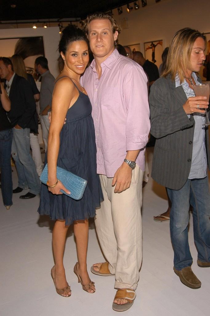 Meghan Markle Wearing a Blue Dress with Trevor Engelson