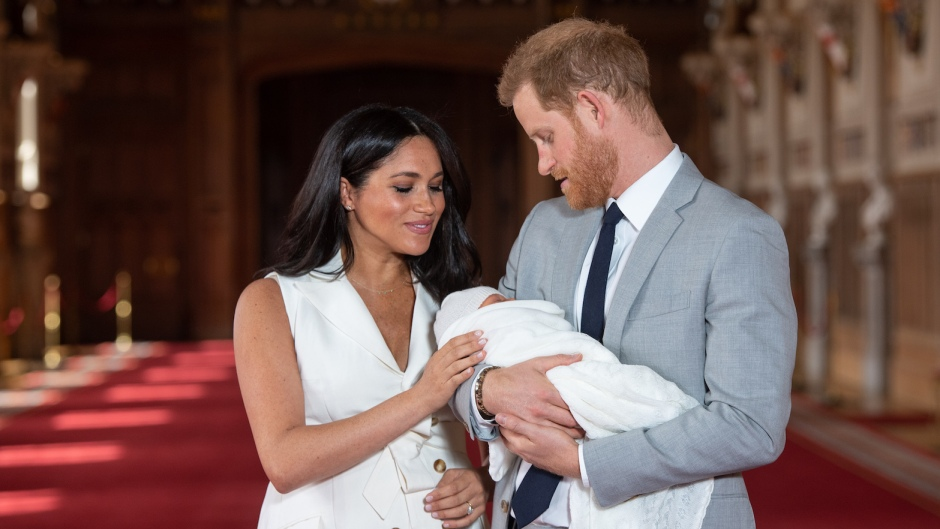 Meghan Markle Wearing White and Prince Harry in a Suit With Their New baby