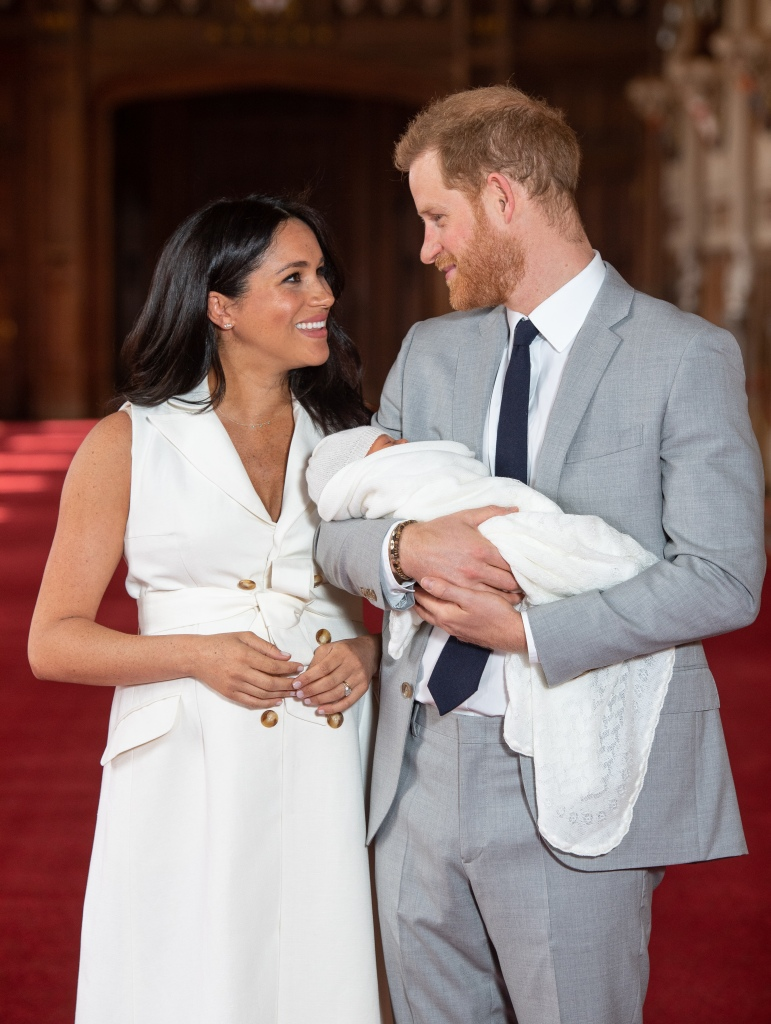 Meghan Markle Wearing White with Prince Harry and Their Baby