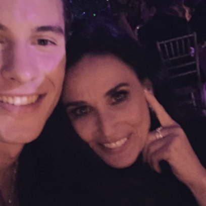Shawn Mendes and Demi Moore posing for a selfie at the 2019 Met Gala