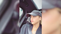 Sofia Richie with no makeup on driving in a car