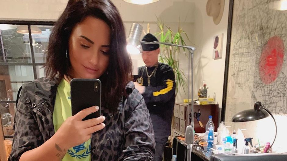 Demi Lovato dr. woo grandma tattoo forearm mirror selfie short hair