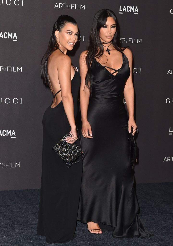 Kim Kardashian Kourtney Kardashian Stand Together in Black Dresses