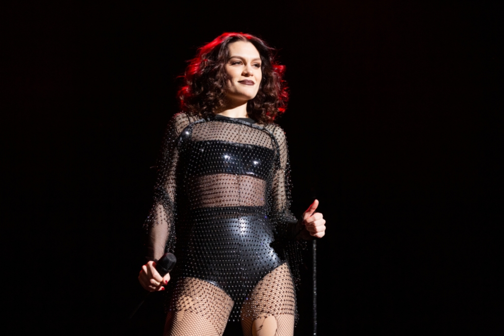 Jessie J black leather outfit on stage concert