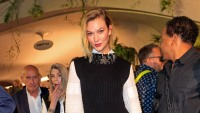 Karlie Kloss Smiles With Short Blonde Hair White Blouse and Black Sweater Dress