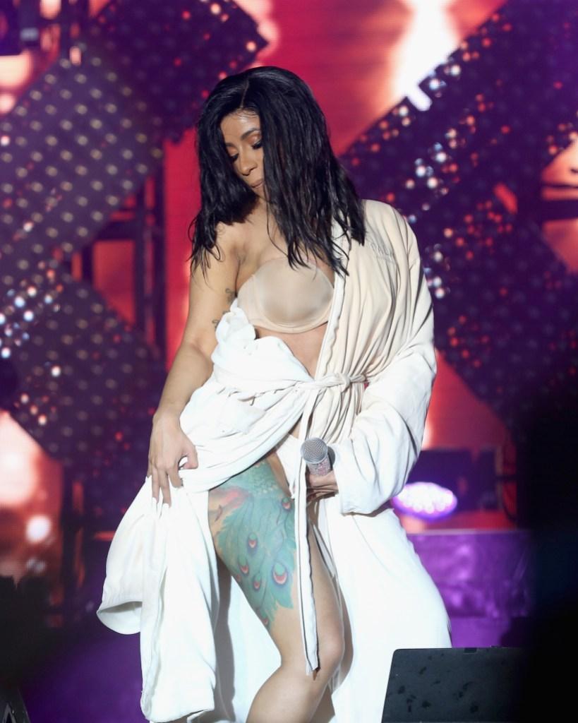 Cardi B Performs in White Bathrobe After Wardrobe Malfunction During Bonnaroo Performance