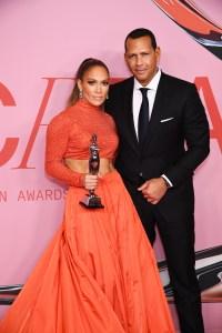 Alex Rodriguez Jennifer Lopez 2019 cfda awards orange midriff top suit red carpet