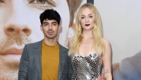 Joe Jonas Sophie Turner game of thrones stunt double relationshiop red carpet got premiere sophie red lipstick shimmery dress