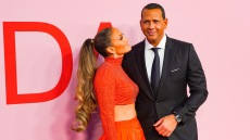 Jennifer Lopez Wears a Sparkly Orange Crop Top With Matching Orange Ball Gown Skirt and Long Curly Ponytail While Staring at Alex Rodriguez in a Black Suit and Black Tie at CFDA Awards