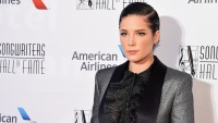 Halsey Holds Songwriters Hall of Fame Award in a Sparkly Silver Tux Jacket With a Black Blouse and Black Leather Leggings and Short Slicked Back Black Hair